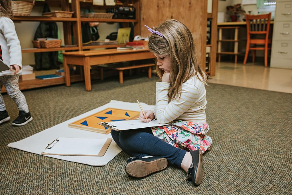 Child Working on Rug