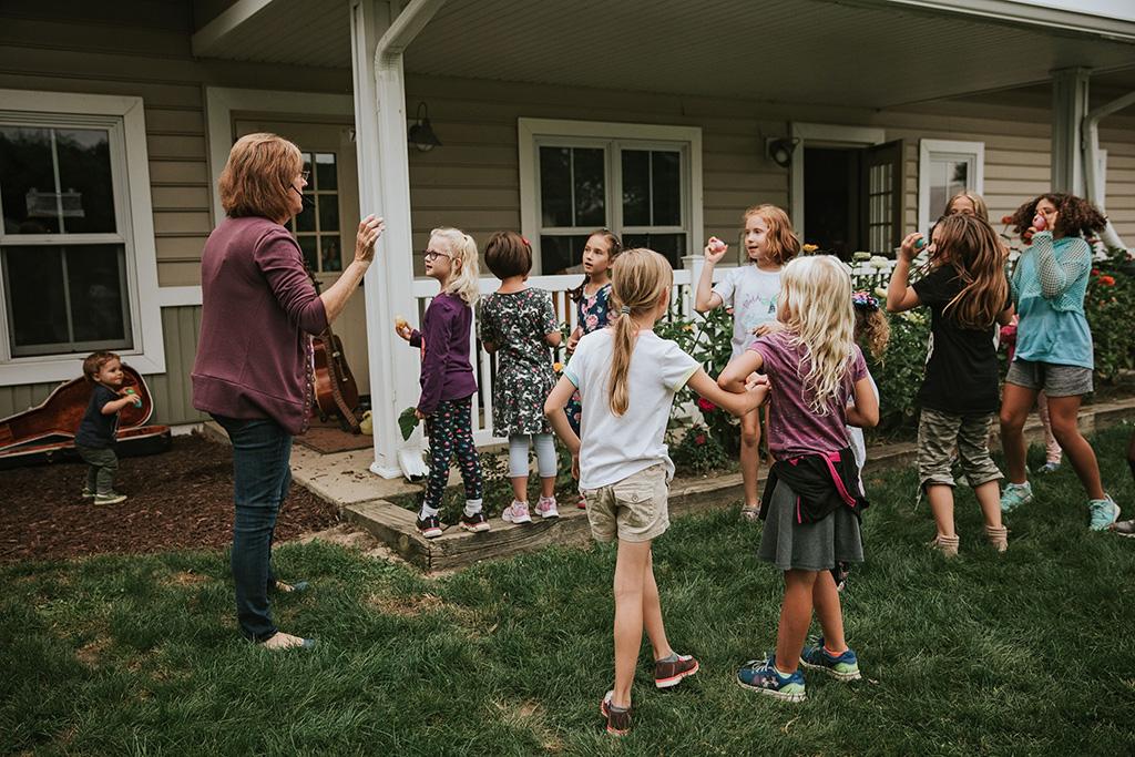 Children outside with Teacher
