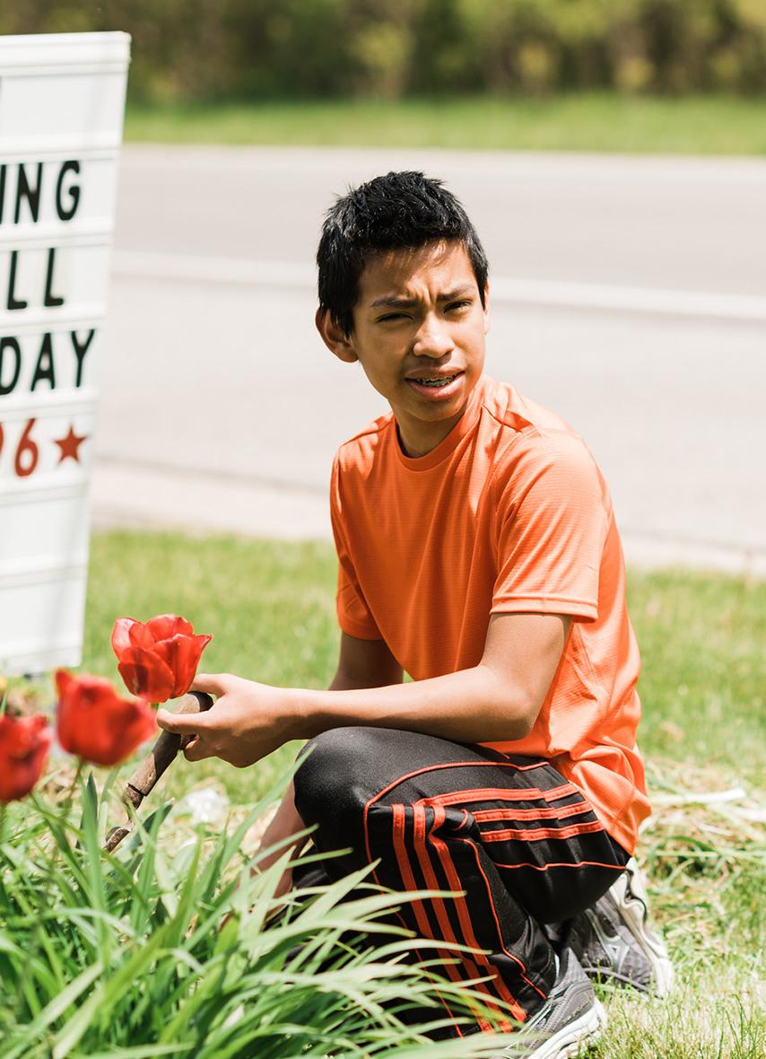 Kid working in Garden with Flowers